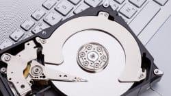 Hard disk HDD over laptop keyboard.